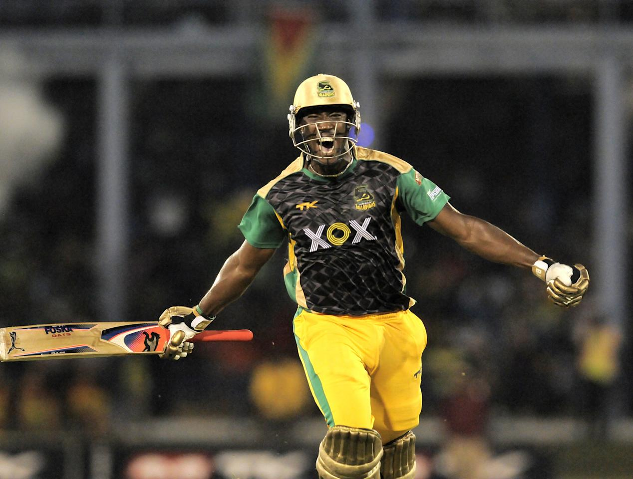 PORT OF SPAIN, TRINIDAD AND TOBAGO - AUGUST 24:  Andre Russell of Jamaica Tallawahs celebrates victory against Guyana Amazon Warriors during the Final of the Caribbean Premier League between Guyana Amazon Warriors v Jamaica Tallawahs at Queens Park Oval on August 24, 2013 in Port of Spain, Trinidad and Tobago. (Photo by Randy Brooks/Getty Images Latin America for CPL)