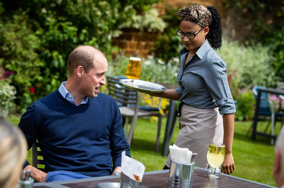 EMBARGOED TO 2230 BST FRIDAY JULY 3 The Duke of Cambridge receives an Aspalls cider at The Rose and Crown pub in Snettisham, Norfolk.