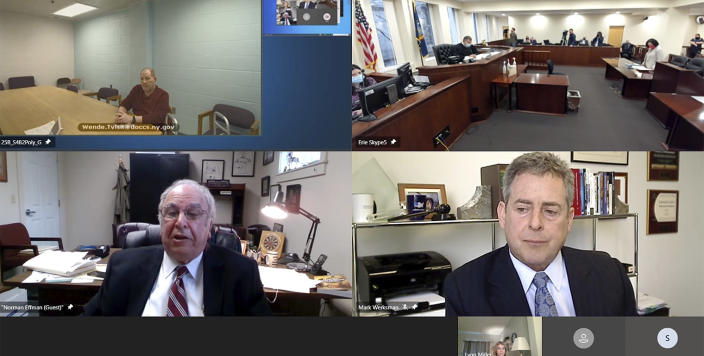 In this still frame taken from video, Harvey Weinstein, upper left, appears via video from prison before Erie County Court before Judge Kenneth Case, top right, as his attorney, Norman Effman, lower left, speaks and Los Angeles based defense attorney Mark Werksman listens in, Monday, April 12, 2021, in Buffalo, N.Y. (New York Unified Court System via AP)