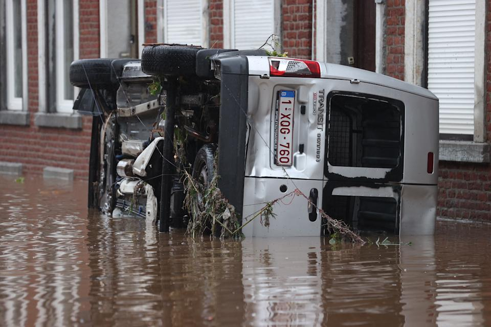LIEGE, BELGIUM - JULY 15: A damaged car is seen at the flooded site after heavy rain hit Oesival town in province of Liege, Belgium on July 15, 2021. Number of people who lost their lives due to floods caused by the rains that lasted for a few days in the country rose to 6. Because of the heavy rains, a state of emergency was declared in cities such as Liege, Verviers and Spa. In Liege, authorities asked those who do not live in the city to leave the area. Residents near the Meuse River were asked to climb to higher floors. River water level is expected to rise 1.5 meters (Photo by Dursun Aydemir/Anadolu Agency via Getty Images)