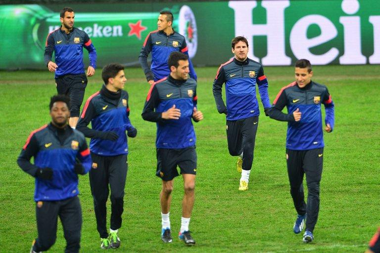 Barcelona train on the eve of their Champions League clash with AC Milan, on February 19, 2013, at the San Siro. Barca travel to Milan without coach Tito Vilanova as he continues treatment in New York to help him recover from a throat cancer operation he underwent before Christmas