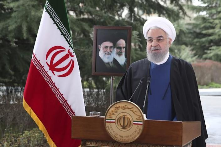 In this photo released on Saturday March 20, 2021 by the official website of the office of the Iranian Presidency, President Hassan Rouhani delivers a message for the Iranian New Year, or Nowruz, in Tehran, Iran. Both the Supreme Leader and President claimed that enemies of Iran have admitted failure in bringing the nation to its knees through maximum pressure. (Iranian Presidency Office via AP)