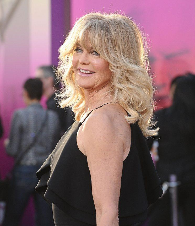 Goldie Hawn poses for a photo on the red carpet.