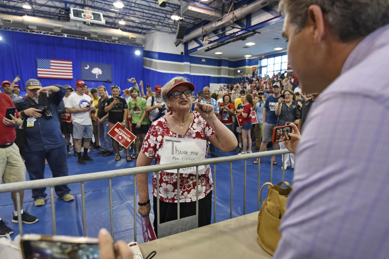 A Trump supporter berates CNN chief White House correspondent Jim Acosta before a rally in West Columbia, S.C., on Monday. (Photo: Richard Shiro/AP)
