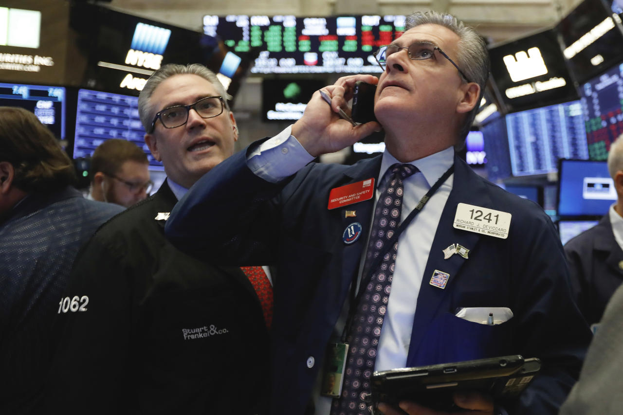 <p> FILE- In this Nov. 8, 2018, file photo traders Eric Schumacher, left, and Richard Deviccaro work on the floor of the New York Stock Exchange. The U.S. stock market opens at 9:30 a.m. EDT on Friday, Nov. 16. (AP Photo/Richard Drew, File) </p>