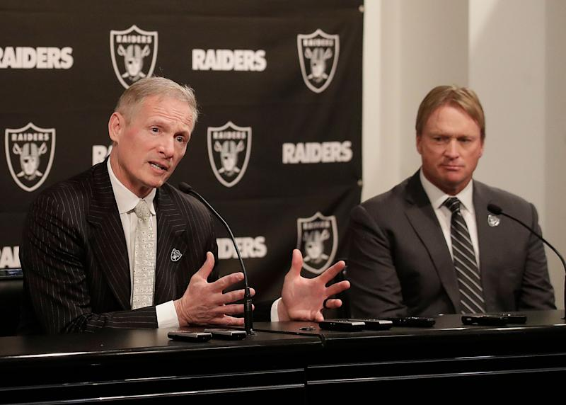 Mike Mayock, left, and Jon Gruden have a lot of options in this week's draft. (AP)