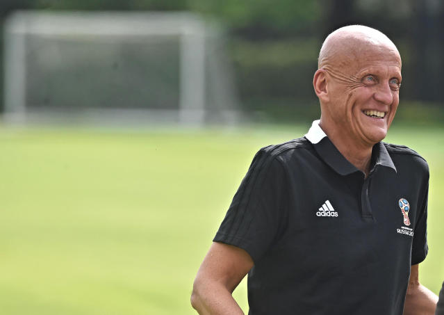 UEFA chief refereeing officer Pierluigi Collina smiles as he attends a meeting to explain how the VAR (Video assistant referee) will be used at the World Cup, at the Coverciano sports center, near Florence, Italy, Wednesday, April 18, 2018. (Maurizio Degl'Innocenti/ANSA via AP)