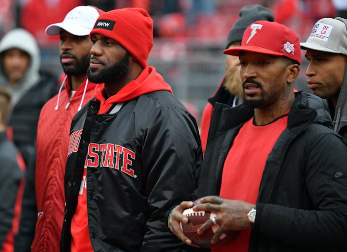 COLUMBUS, OH - NOVEMBER 26:   (R-L) J.R. Smith and Lebron James of the Cleveland Cavaliers are seen on the field prior to the game between the Michigan Wolverines and Ohio State Buckeyes at Ohio Stadium on November 26, 2016 in Columbus, Ohio.  (Photo by Jamie Sabau/Getty Images)