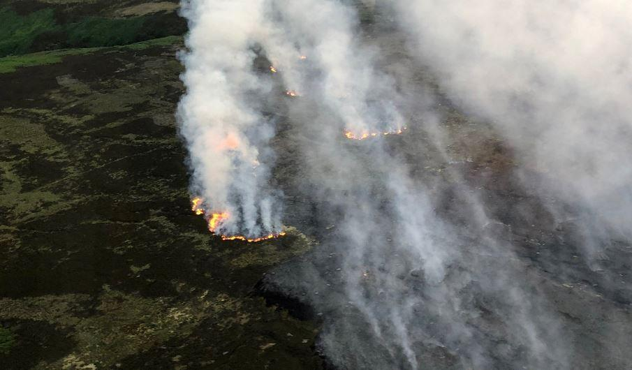 Smoke rises across the moor on Monday (Picture: SWNS)