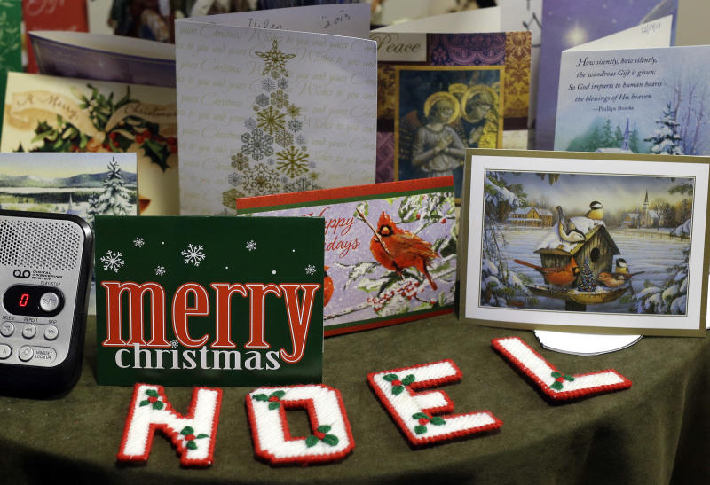 This Dec. 21, 2013, photo shows Christmas cards from residents at Village Crossroads, an affordable senior community in Nottingham, Md., on a table in resident Helen Hatchell's apartment. (AP Photo/Patrick Semansky)