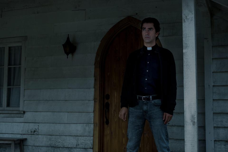 """Father Paul (Hamish Linklater) is a man of many secrets who brings a monster to Crockett Island in """"Midnight Mass."""""""