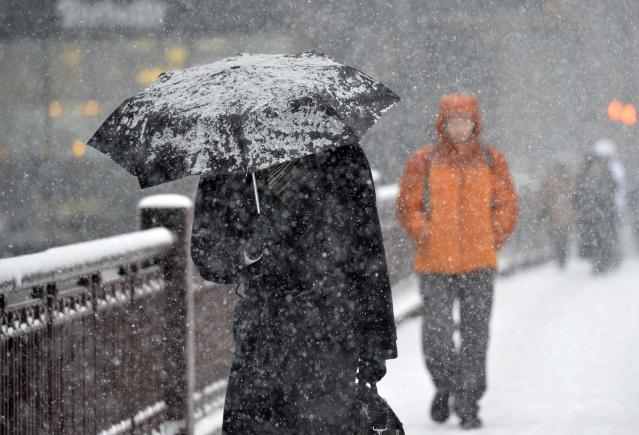 CHICAGO, IL - MARCH 5: A pedestrian shields himself with an umbrella as he walks down the street on March 5, 2013 in Chicago, Illinois. The worst winter storm of the season is expected to dump 7-10 inches of snow on the Chicago area with the worst expected for the evening commute. (Photo by Brian Kersey/Getty Images)