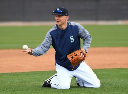Feb 18, 2019; Peoria, AZ, USA; Seattle Mariners third baseman Kyle Seager (15) fields ground balls during a spring training workout at the Peoria Sports Complex. Mandatory Credit: Jayne Kamin-Oncea-USA TODAY Sports
