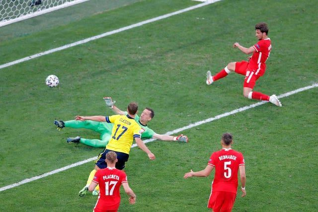 Viktor Claesson scores the winner for Sweden against Poland to ensure they topped Group E