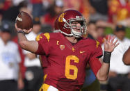 Southern California quarterback Cody Kessler prepares to pass during the first half of an NCAA college football game against Notre Dame, Saturday, Nov. 29, 2014, in Los Angeles. (AP Photo/Mark J. Terrill)