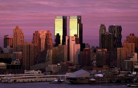 The setting sun reflects off of the twin towers of Time Warner Center in New York City