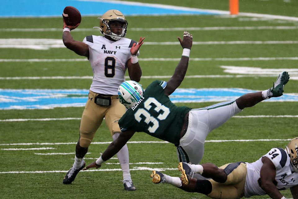 NEW ORLEANS, LOUISIANA - SEPTEMBER 19: Dalen Morris #8 of the Navy Midshipmen throws a pass against the Tulane Green Wave at Yulman Stadium on September 19, 2020 in New Orleans, Louisiana. (Photo by Chris Graythen/Getty Images)