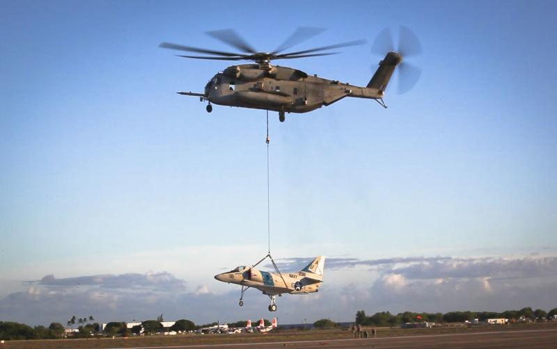 A CH-53E Super Stallion, used by the Marine Heavy Helicopter Squadron 463, carries off an A-4 Jet during a sling load operation aboard Barber's Point Naval Air Station, Marine Corps Base Hawaii on September 23, 2014, in this handout photo provided by the U.S. Marine Corps. The U.S. Coast Guard is searching for two Marine helicopters carrying 12 people after reports that they collided near the island of Oahu in Hawaii, media reports said on January 15, 2016. REUTERS/U.S. Marine Corps/Lance Cpl. Aaron S. Patterson/Handout via Reuters  ATTENTION EDITORS -  FOR EDITORIAL USE ONLY. NOT FOR SALE FOR MARKETING OR ADVERTISING CAMPAIGNS. THIS IMAGE HAS BEEN SUPPLIED BY A THIRD PARTY. IT IS DISTRIBUTED, EXACTLY AS RECEIVED BY REUTERS, AS A SERVICE TO CLIENTS