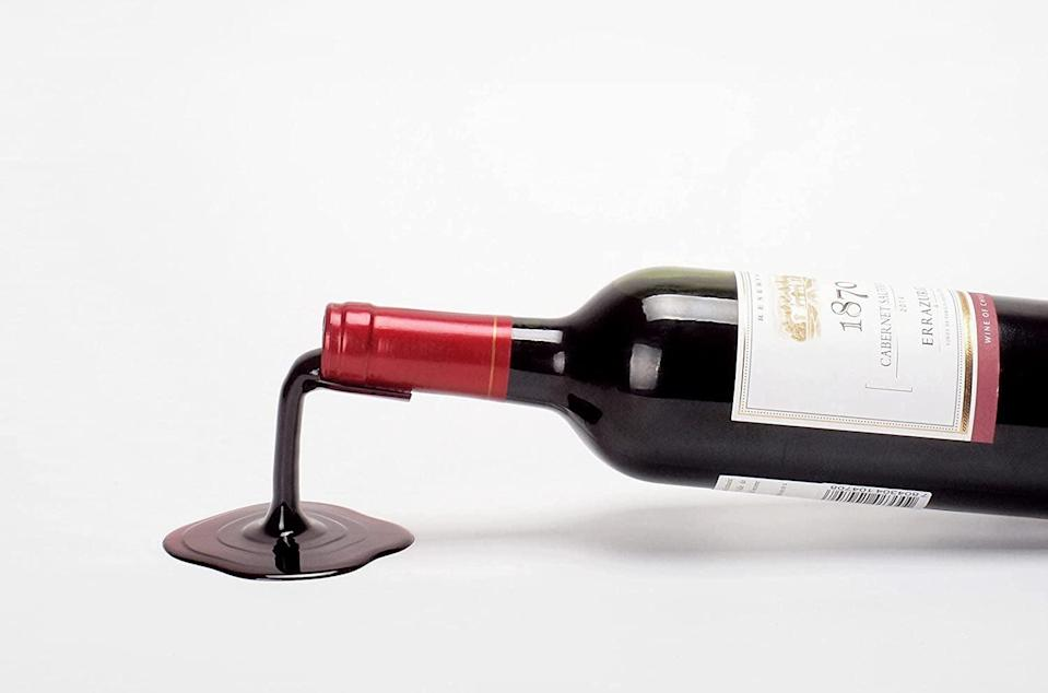 <p>This <span>Playable Art Spilled Wine Bottle Holder </span> ($18) is so darn clever.</p>
