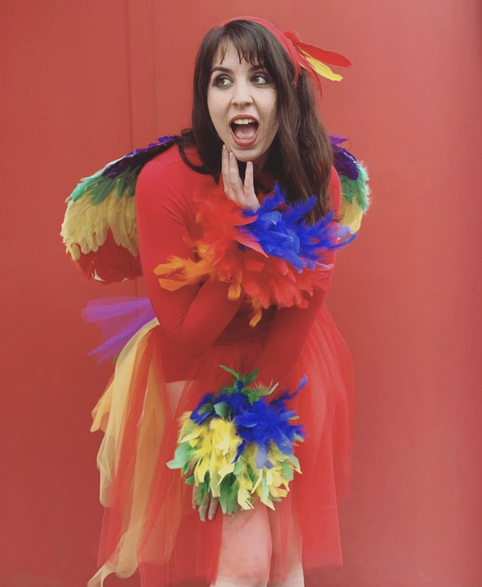 """<p>For ease, buy a pair of parrot wings, then glue some extra feathers to the sleeves and hemline of a red dress. </p><p><a class=""""link rapid-noclick-resp"""" href=""""https://www.instagram.com/p/B9jWV4RFwCn/"""" rel=""""nofollow noopener"""" target=""""_blank"""" data-ylk=""""slk:SEE MORE"""">SEE MORE</a></p><p><a class=""""link rapid-noclick-resp"""" href=""""https://www.amazon.com/Adult-Rainbow-Feather-Carnival-Accessory/dp/B071HX7YNJ?tag=syn-yahoo-20&ascsubtag=%5Bartid%7C10072.g.33547559%5Bsrc%7Cyahoo-us"""" rel=""""nofollow noopener"""" target=""""_blank"""" data-ylk=""""slk:SHOP PARROT WINGS"""">SHOP PARROT WINGS</a></p>"""