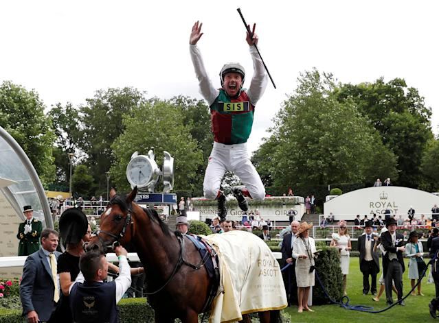 Horse Racing - Royal Ascot - Ascot Racecourse, Ascot, Britain - June 19, 2018 Frankie Dettori jumps off Without Parole as he celebrates winning the 4.20 St James's Palace Stakes Action Images via Reuters/Paul Childs TPX IMAGES OF THE DAY