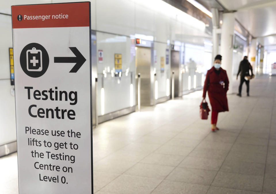 Photo by: zz/KGC-254/STAR MAX/IPx 2021 2/12/21 Signs directing airline passengers to a COVID-19 Testing Centre are seen on February 12, 2021 at London Heathrow Airport during the worldwide coronavirus pandemic. Emergency lockdown restrictions are continued in The United Kingdom as health officials take measures to prevent a new variant of the virus from affecting greater Europe. (London, England, UK)