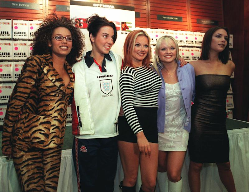 The Spice Girls, Victoria, Mel C, Geri, Emma, and Mel B, pose for a group portrait in New York Friday, April 11, 1997. (AP Photo/Emile Wamsteker)