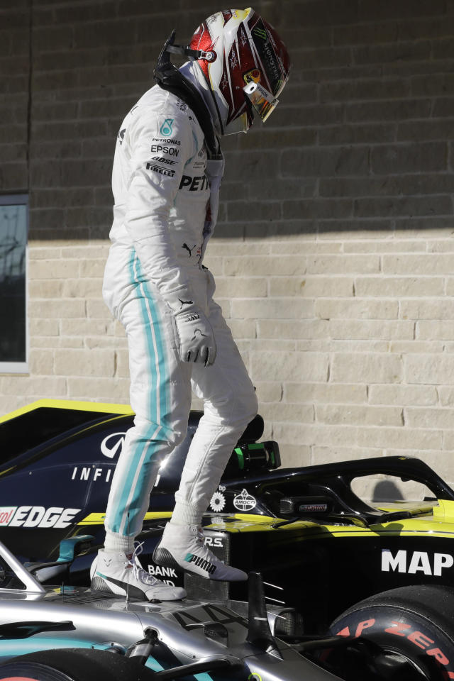 Mercedes driver Lewis Hamilton, of Britain, get out of his car after the qualifying session for the Formula One U.S. Grand Prix auto race at the Circuit of the Americas, Saturday, Nov. 2, 2019, in Austin, Texas. (AP Photo/Darron Cummings)
