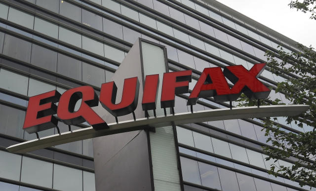 FILE- This July 21, 2012, file photo shows signage at the corporate headquarters of Equifax Inc. in Atlanta. On Wednesday, March 28, 2018, Equifax announced that Mark Begor will become its CEO as the credit reporting company continues to try to recover from fallout surrounding a massive data breach. (AP Photo/Mike Stewart, File)