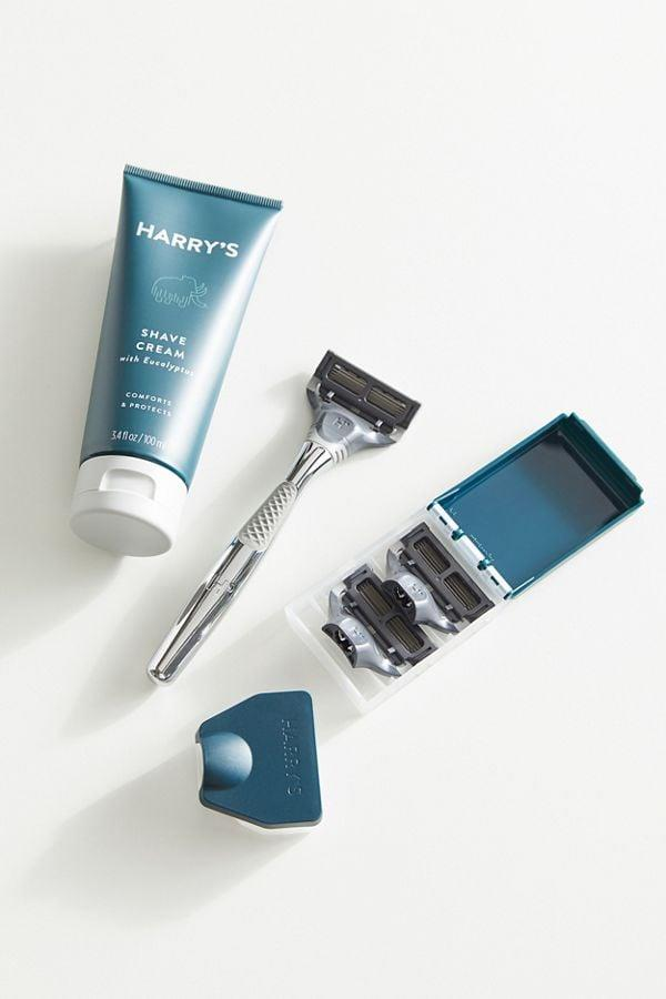 "<p>The guy in your life will appreciate this <a href=""https://www.popsugar.com/buy/Harry-Winston-Shave-Set-364432?p_name=Harry%27s%20Winston%20Shave%20Set&retailer=urbanoutfitters.com&pid=364432&price=30&evar1=savvy%3Aus&evar9=45267830&evar98=https%3A%2F%2Fwww.popsugar.com%2Fphoto-gallery%2F45267830%2Fimage%2F45532069%2FHarry-Winston-Shave-Set&list1=shopping%2Cgifts%2Choliday%2Cgift%20guide&prop13=api&pdata=1"" rel=""nofollow"" data-shoppable-link=""1"" target=""_blank"" class=""ga-track"" data-ga-category=""Related"" data-ga-label=""https://www.urbanoutfitters.com/shop/harrys-winston-shave-set?category=mens-grooming&amp;color=007"" data-ga-action=""In-Line Links"">Harry's Winston Shave Set</a> ($30).</p>"