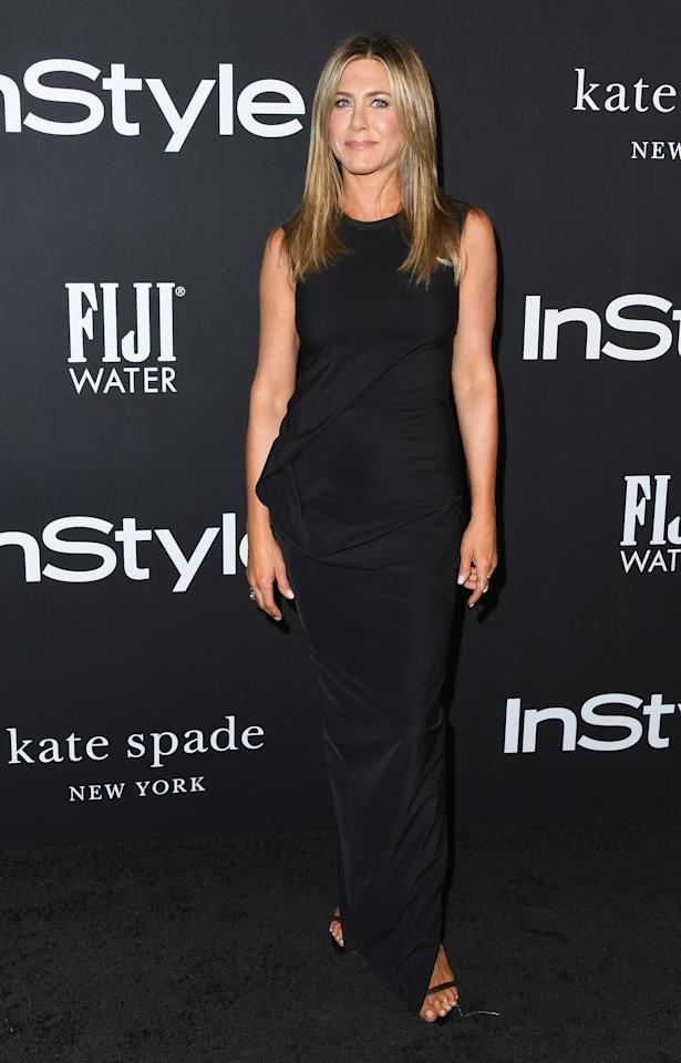 <p>Not one for prints and patterns, Jennifer kept her look streamlined and simple in a black column dress. <em>[Photo: Getty]</em> </p>