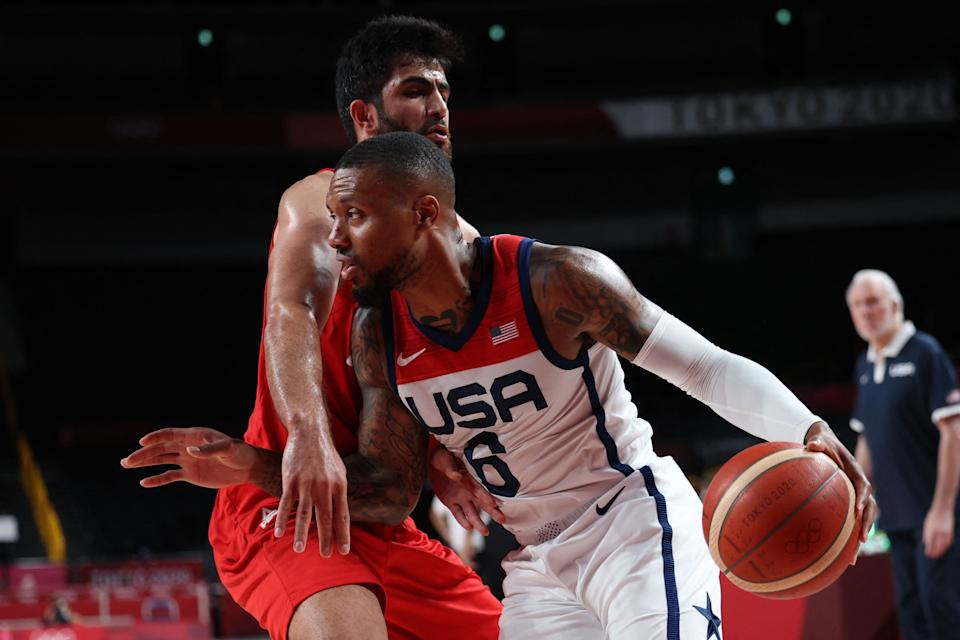 Damian Lillard (6) and Team USA bounced back from a loss to France by blowing out Iran. (Photo by THOMAS COEX/AFP via Getty Images)