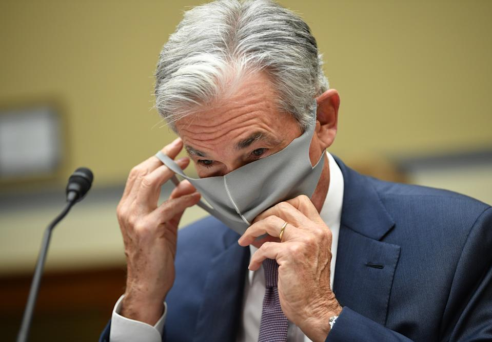 Federal Reserve Chair Jerome Powell puts on his face mask as he prepares to testify during a US Senate Senate Health, Education, Labor, and Pensions Committee hearing to examine covid-19, focusing on an update on the federal response in Washington, DC, on September 23, 2020. (Photo by KEVIN DIETSCH / various sources / AFP) (Photo by KEVIN DIETSCH/AFP via Getty Images)