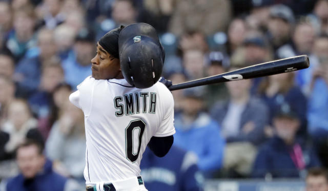 Seattle Mariners' Mallex Smith loses his batting helmet as he swings and misses to strike out against the Houston Astros in the first inning of a baseball game Saturday, April 13, 2019, in Seattle. (AP Photo/Elaine Thompson)