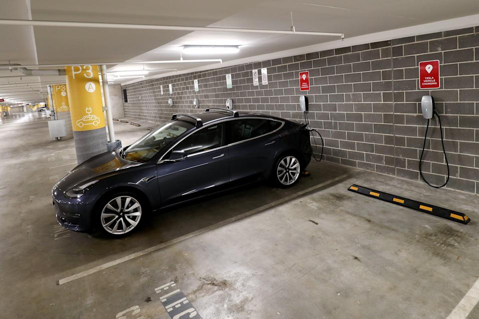 <p>A Tesla Model Y charges at a EV charge station in Lane Cove, Australia</p> (Getty Images)