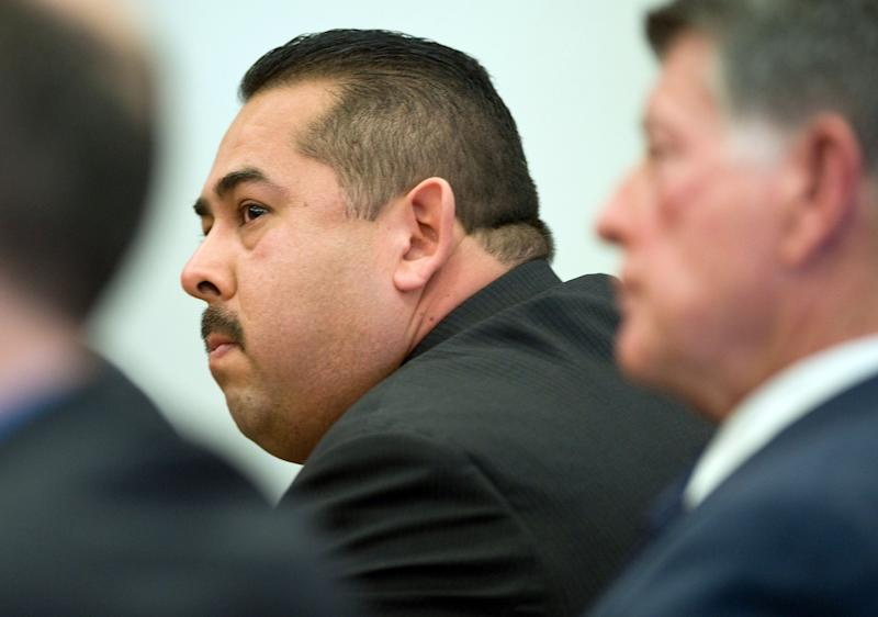 ADDS LOCATION-Former Fullerton police Officer Manuel Ramos reacts after being acquitted Monday Jan. 13, 2014, in Santa Ana, Calif., of second-degree murder and involuntary manslaughter charges stemming from the 2011 death of transient Kelly Thomas. (AP Photo/Mindy Schauer, Pool)