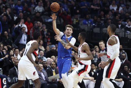 Dec 4, 2018; Dallas, TX, USA; Dallas Mavericks forward Luka Doncic (77) passes the ball past Portland Trail Blazers forward Al-Farouq Aminu (8) and forward Maurice Harkless (4) and guard Damian Lillard (0) during the second half at American Airlines Center. Mandatory Credit: Kevin Jairaj-USA TODAY Sports