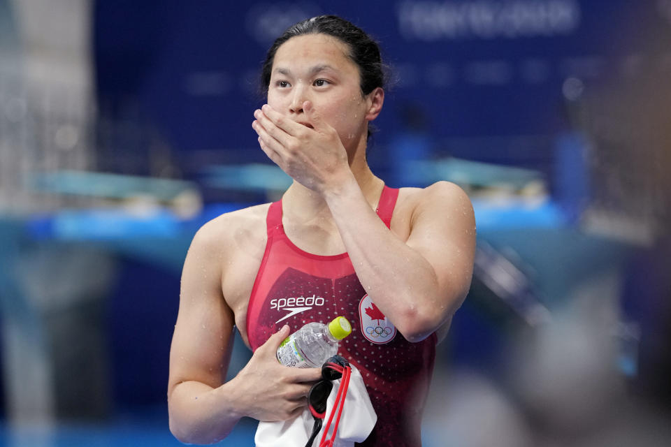 Margaret MacNeil of Canada leaves the pool after winning the final of the women's 100-meter butterfly at the 2020 Summer Olympics, Monday, July 26, 2021, in Tokyo, Japan. (AP Photo/Martin Meissner)