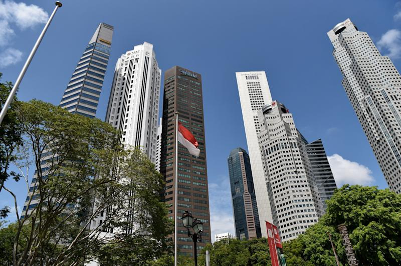 A general view of highrise office buildings at Raffles Place in Singapore on May 29, 2017. / AFP PHOTO / ROSLAN RAHMAN (Photo credit should read ROSLAN RAHMAN/AFP/Getty Images)
