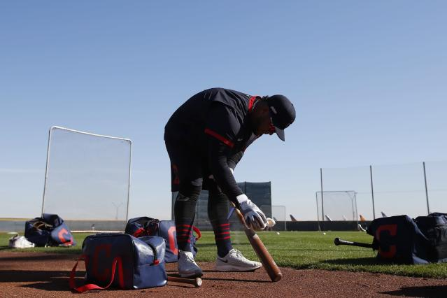 Cleveland Indians' Wilson Garcia gets a bat ready as early arrival position players take batting practice during spring training baseball workouts Friday, Feb. 14, 2020, in Avondale, Ariz. (AP Photo/Ross D. Franklin)