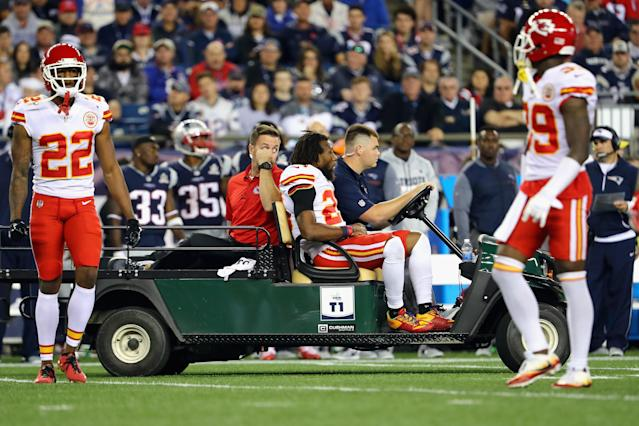 Eric Berry gets carted off at Gillette Stadium on Thursday night in New England. (Getty)