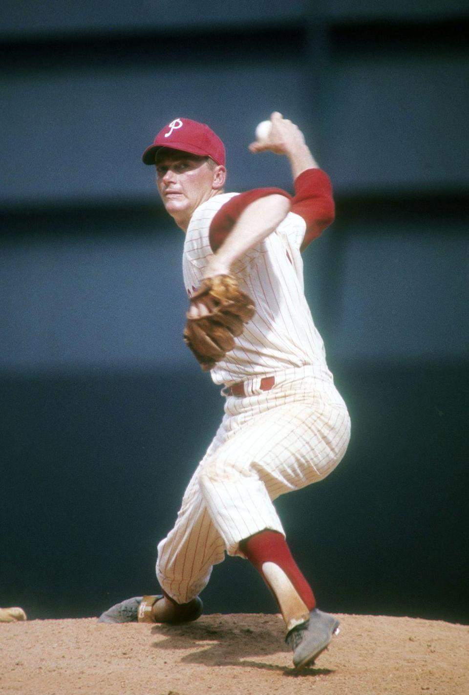 """<p><strong>June 21, 1964</strong>: In the first game of a Father's Day doubleheader at Shea Stadium, Jim Bunning of the National League-leading Phillies pitches a perfect game, defeating the 10th-place New York Mets. It's only the fifth perfect game in baseball history, and the ace right-hander needs just 90 pitches to complete the game. With the 27-up, 27-down victory, Bunning becomes the first player to hurl a no-hitter in both leagues. (He also blanked the Red Sox in 1958 while pitching for the Detroit Tigers.) """"What a day for the daddy of seven children who experienced a career game that Father's Day,"""" says Frommer.<br> </p>"""