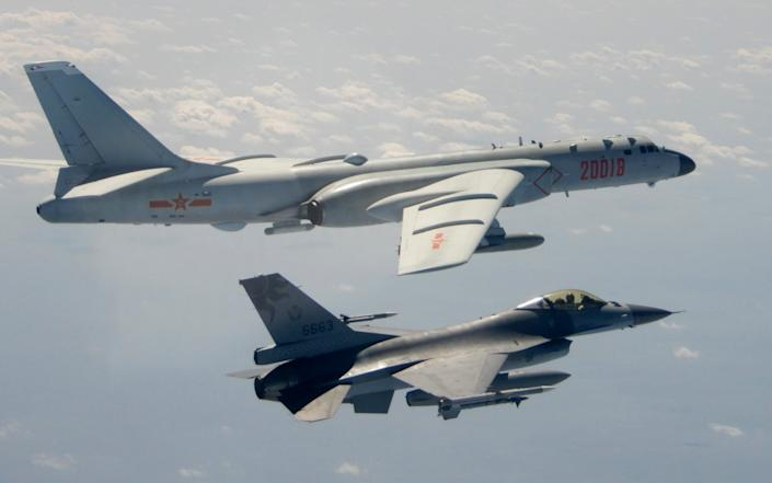 A Taiwanese F-16 flies on the flank of a PLAAF H-6 bomber - AP