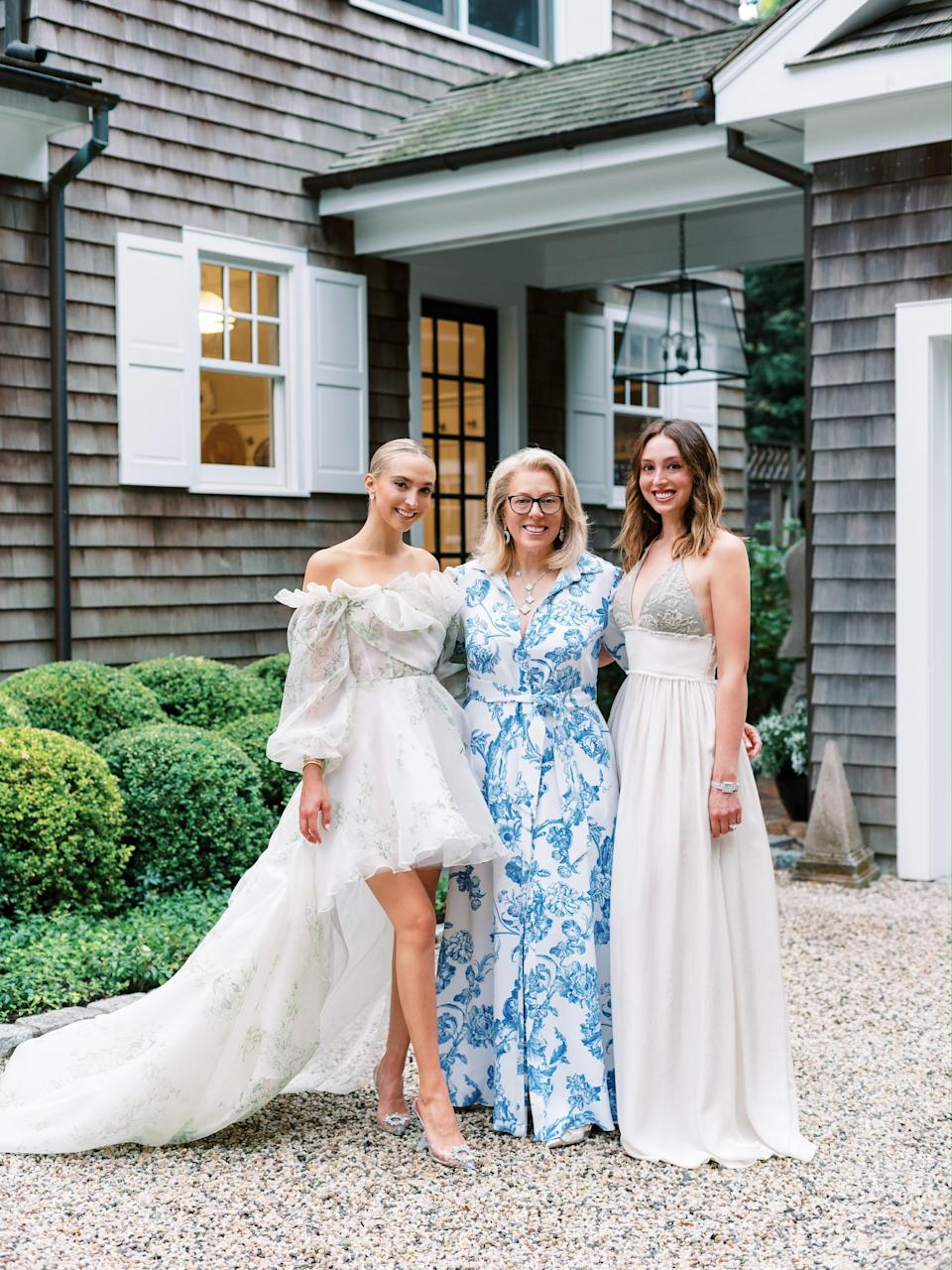 Me, my mom, Amy, and my sister, Hilary. My mom wore Oscar de la Renta and my sister wore Brunello Cucinelli. Both of their dresses were originally supposed to be worn to different weekend festivities in France, but they ended up being so perfect for this setting.