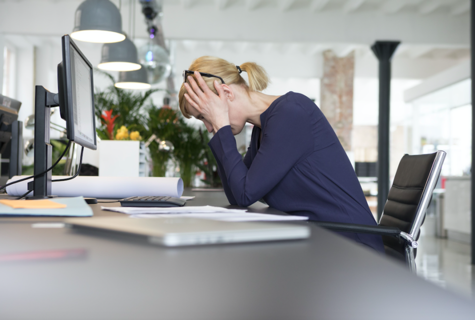 Workplace stress is a huge factor among UK workers (Picture: Rex)