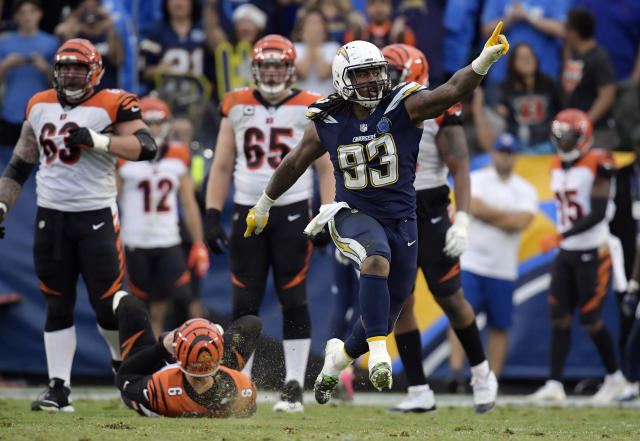 <p>Los Angeles Chargers defensive tackle Darius Philon (93) celebrates after sacking Cincinnati Bengals quarterback Jeff Driskel, bottom left, on a two-point conversion attempt late in the fourth quarter during an NFL football game Sunday, Dec. 9, 2018, in Carson, Calif. (AP Photo/Mark J. Terrill) </p>