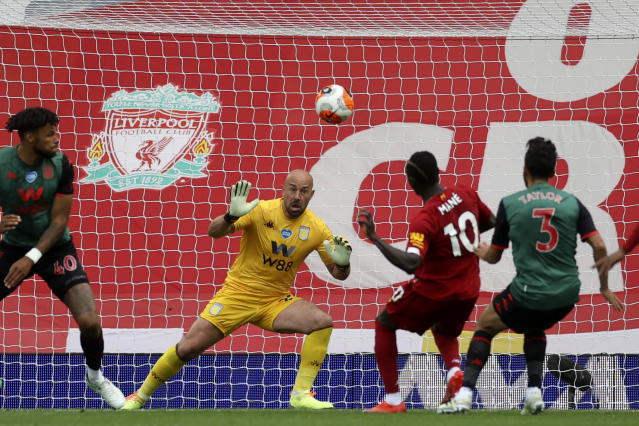 Liverpool's Sadio Mane, 2nd right, scores the opening goal during the English Premier League soccer match between Liverpool and Aston Villa at Anfield Stadium in Liverpool, England, Sunday, July 5, 2020. (Carl Recine/Pool via AP)