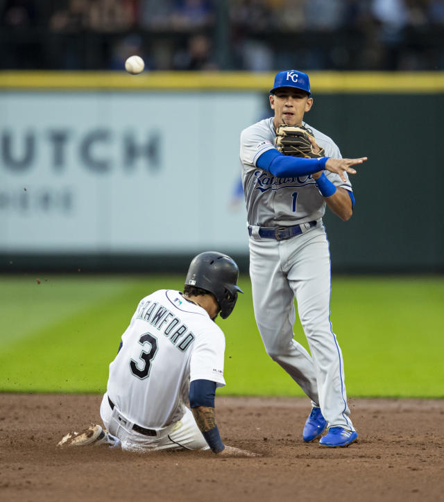Kansas City Royals second baseman Nicky Lopez turns a double play after forcing out Seattle Mariners' J.P. Crawford at second base on a hit by Domingo Santana during the third inning of a baseball game, Monday, June 17, 2019, in Seattle. (AP Photo/Stephen Brashear)