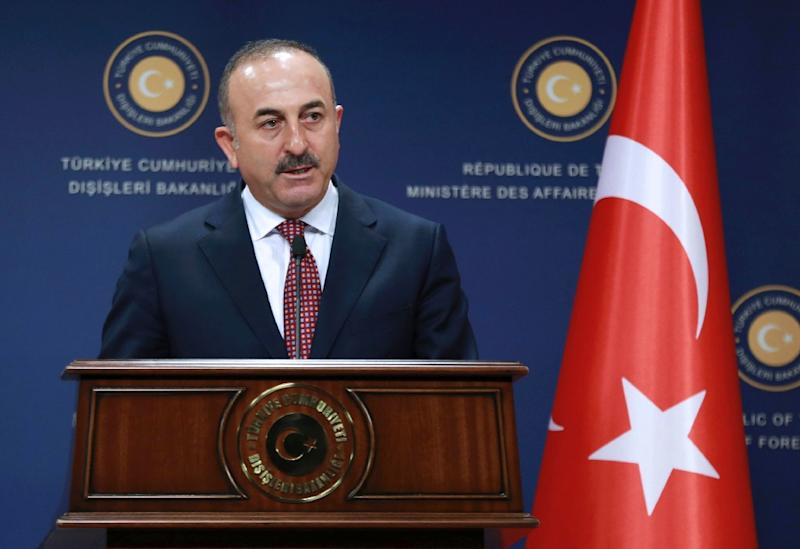 Turkish Foreign Minister Mevlut Cavusoglu addresses a joint press conference with his Iranian counterpart following their meeting at the Foreign Ministry in Ankara