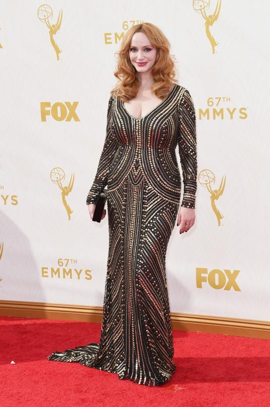 """<p>Christina Hendricks said she was going to wear something unlike anything she'd worn before and she did not disappoint. Surprising her fans in a fitted dress, the """"Mad Men"""" actress wore a Naeem Khan dress completely embellished in metal all arranged in a geometric pattern.</p>"""